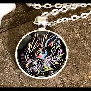 Colorful hand drawn fantasy dragon art pendant